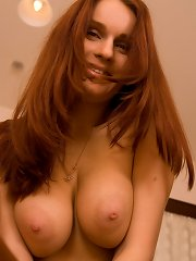 Yulia strips off to reveal her melons and dildo pounds pussy