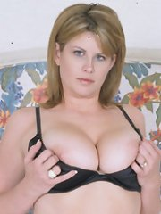 Big busty babe takes two dicks at once!