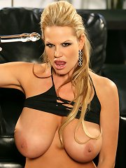 Kelly uses a leather and crystal dildo while wearing a black bikini.