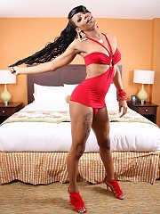 Ebony t-girl Kimora was shy for her first time in front of the camera, but her cock definitely liked all the attention!