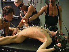 Chained twink has hot wax singe his skinny body