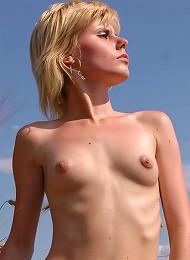 Russian beauty walks in the fields.