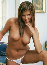 Stunning blonde gets naked on the couch