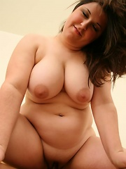 Smooth skinned plumper squeezing her huge pink nipped tits