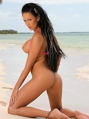 Amazing bikini model Regina Moon posing in pink bikinis then gets naked and show us her attributes