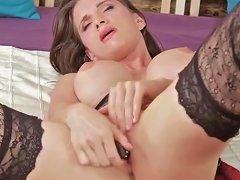 Babe with big fake tits masturbates in stockings