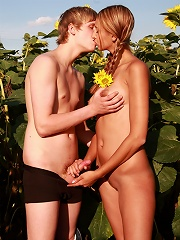 Behind the tall sunflower plants, these teens are able to hide their naughty acts. They cant wait to have sex, but just hope that no one spots them wh