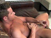 Naked and muscled Benjamin Bradley masturbates