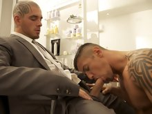 Incredibly sexy and fully-tatted Logan McCree goes to his local barber shop to trim his beard. But as the barber is giving Logan a close shave with on
