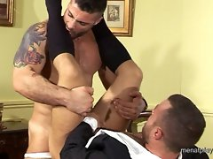 Brutal muscle top fucks a horny dude really hard on an office table