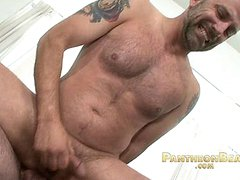 Hairy older bear riding a mature cock