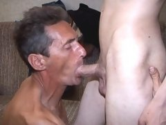 Grey haired mature gay teaches various techniques of gay sex to sweet twink.