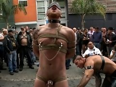 A muscled and hung stud getting stripped naked and humiliated in public.