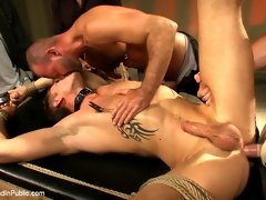 Btural Trent Diesel gets tied up, receives cocks and cumshot in all directions