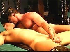 Two muscle leathermen exploring the real and very deep connection they share in their roles as Master and boy.