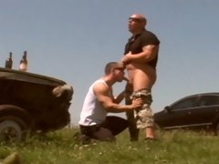 Two muscle-bound crims hold a gorgeous young man captive in the trunk of a car. They lock him in, and wander off to drink beer and fuck like brutes, g