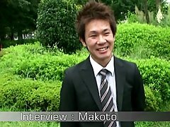 Japanese business man Makoto takes off his suite and stroking on the bed