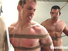 A rope gay bondage scene in the shower with fisting and hard fucking