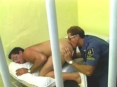 A horny cop licks prisoner's asshole and bangs him in a cell