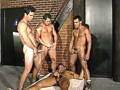 Muscled gays pack an ass with two cocks, and then shoot their cum on one