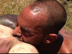 Two muscled gay bears have some hot bareback sex outdoors