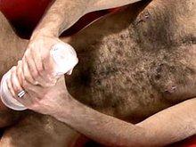 A very hairy bear Mikel gets naked and masturbates his big cock