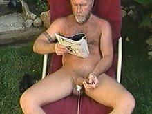 Bearded old man jerks off outside