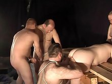 This bear orgy heats up with cock sucking and ass fucking making all of them ready to erupt