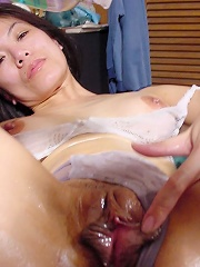 Naughty asian babe spreads her pussy and deeply finger it