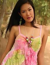 Busty Thai Cutie Irene Fah Strips Dress In Glade