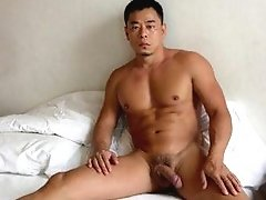 Pervert Asian dude is naked jerking his cock until he cums