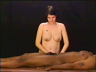 Putting Lube On Her Hands And Jerking Off A Black Cock