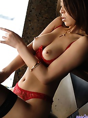 Lovely Asian lingerie model shows her firm tits and inviting pussy