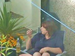 Elaine Relaxing In Her Garden Wh