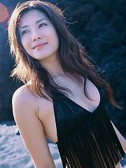 Captivating asian goddess seduces in her skimpy black bikini
