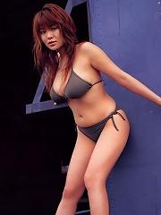 Voluptuous asian hottie at the beach in her skimpy little bikinis