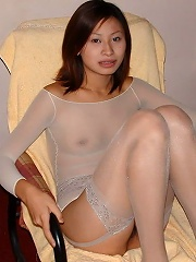 spreading in light colored sheer stockings from this cute asian