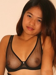 Cute young Asian babe poses naughtily for the cameraman