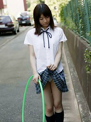 Japanese coed in uniform shows her tight virgin pussy here