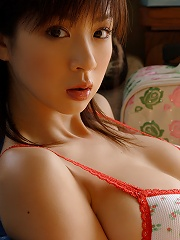 Busty gravure idol showing off her tight little body in lingerie
