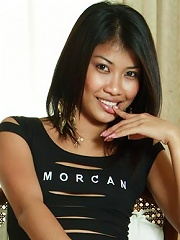Hot Thai girl Som fingers herself in a chair!