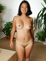 Tiny Indonesian babe gets naked for you!